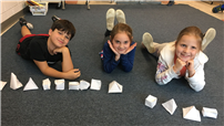 Second-Graders Study Shapes, Describe Heroes photo