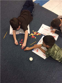 Third-Grade Students Work to Master Multiplication photo 2